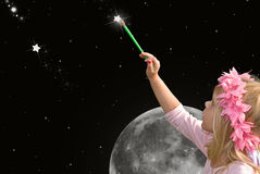 little girl painting star in sky Stock Photography