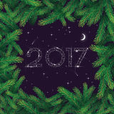 2017 star pine branch. Happy New Year greeting card. 2017 numbers in the night sky made of stars in pine branch frame Royalty Free Stock Image