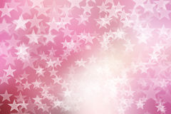 Star on pink and white, abstract bokeh background Royalty Free Stock Photos