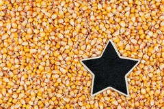 Star, pointer, price, tag, lies on  corn Stock Photography