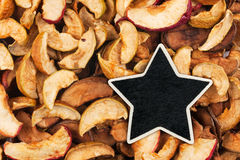 Star, pointer, price, tag, lies on dried  apple Royalty Free Stock Photos