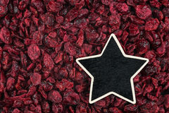 Star, pointer, price, tag, lies on dried cranberries Stock Image