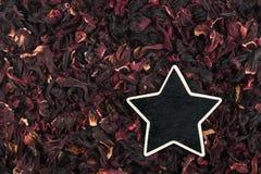 Star, pointer, price, tag, lies on hibiscus Stock Image