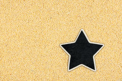 Star, pointer, price, tag, lies on millet Royalty Free Stock Photography