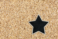 Star, pointer, price, tag, lies on  oat Stock Photo