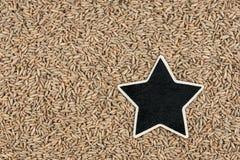 Star, pointer, price, tag, lies on  rye Stock Photos