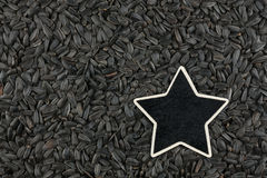 Star, pointer, price, tag, lies on sunflower  seeds Stock Photography