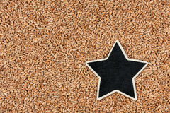 Star ,pointer, price, tag, lies on  wheat Royalty Free Stock Image