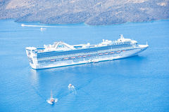 Star Princess close to volcanic islet. Royalty Free Stock Photos