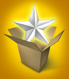 Star product. New star product represented by a glowing star in an opened cardboard box showing the presentation of an important event featuring an important Stock Photos