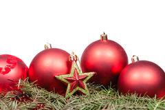 Star and red Christmas balls on spruce branch Royalty Free Stock Photo