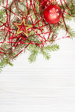 Star and red Xmas bauble and twig on blank paper Royalty Free Stock Photo