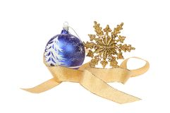 Star ribbon and bauble motif. Christmas decoration, snow scene bauble with a gold glitter star and gold ribbon isolated against white Royalty Free Stock Photography