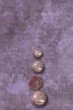 Star ruby column small on mauve wall Stock Photos