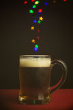 Star shape bokeh lights floating out of beer glass Royalty Free Stock Images