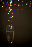 Star shape bokeh lights floating out of Champagne glass Stock Photos