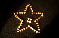 Star shape with candles. At night Stock Images