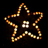 Star shape with candles. At night Royalty Free Stock Photography