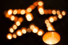 Star shape with candles. At night Stock Photography