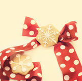 Star shape chrismtas gingerbread. Tie red with dots Stock Photography