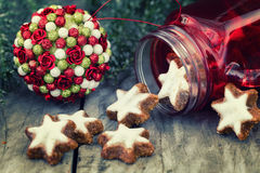Star shape Christmas cookie on a wooden background, with festive Stock Photography