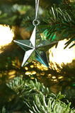 Star shape Christmas ornament shining in silver Stock Photography