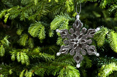 Star shape Christmas ornament in silver Royalty Free Stock Images