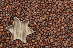 Star shape in coffee beans. Royalty Free Stock Photos