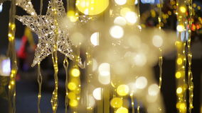 Star shape lightning on a street decorated for Christmas stock footage