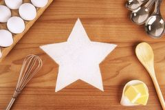 Star shape made with cooking flour on a wooden table. Stock Images