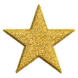 Star shape ornament in gold. Bright studio isolation of a glittering gold star ornament Stock Photos