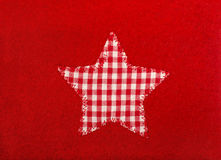 Star shape on red wool background. Royalty Free Stock Photo