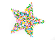Star shaped assorted rainbow colored sprinkles. Isolated on white background royalty free stock image