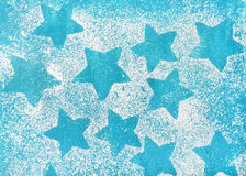 Star shaped biscuits silhouettes over bright blue background Royalty Free Stock Photos