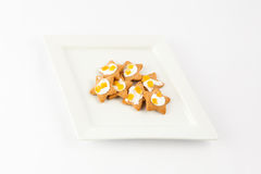 Star shaped biscuits on plate royalty free stock photo