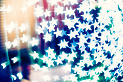 Star shaped blurred bokeh background Stock Photo