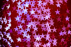 Star shaped blurred bokeh background with sparkles Royalty Free Stock Photography