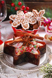 Star shaped cake with dried fruits and gingerbread cookies for c Royalty Free Stock Photography