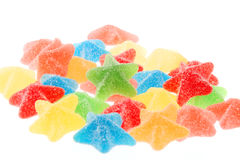 Star shaped candies. Colored fruit flavored star shaped candies isolated on white Stock Photo