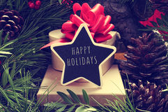 Star-shaped chalkboard with the text happy holidays Royalty Free Stock Photo