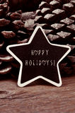 Star-shaped chalkboard with the text happy holidays Stock Photo