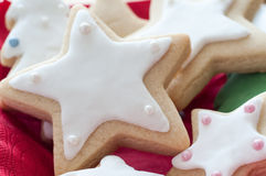 Star Shaped Christmas Biscuits with White Icing Stock Photo