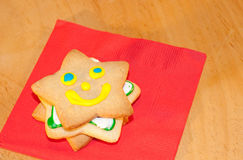 Star shaped Christmas cookie with a happy face Royalty Free Stock Photos