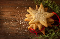 Star shaped christmas cookies and pine tree branch on wood Royalty Free Stock Images