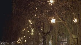 Star Shaped Christmas Decoration and Lights. Beautiful shining star shaped LED Christmas decoration on the street at night stock footage