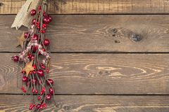 Christmas ornament of stars on background. Star shaped Christmas ornament decoration on wood background with berries royalty free stock photography