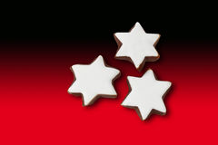 Star shaped christmas pastries on red and black background Royalty Free Stock Photos