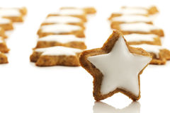 Star shaped cinnamon biscuit in front of many Royalty Free Stock Photography