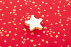 Star shaped cinnamon biscuit on red background Stock Images
