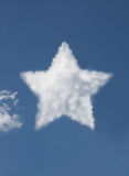 Star shaped cloud. In blue sky royalty free stock photography